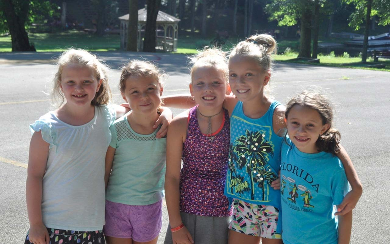 Five happy girl campers