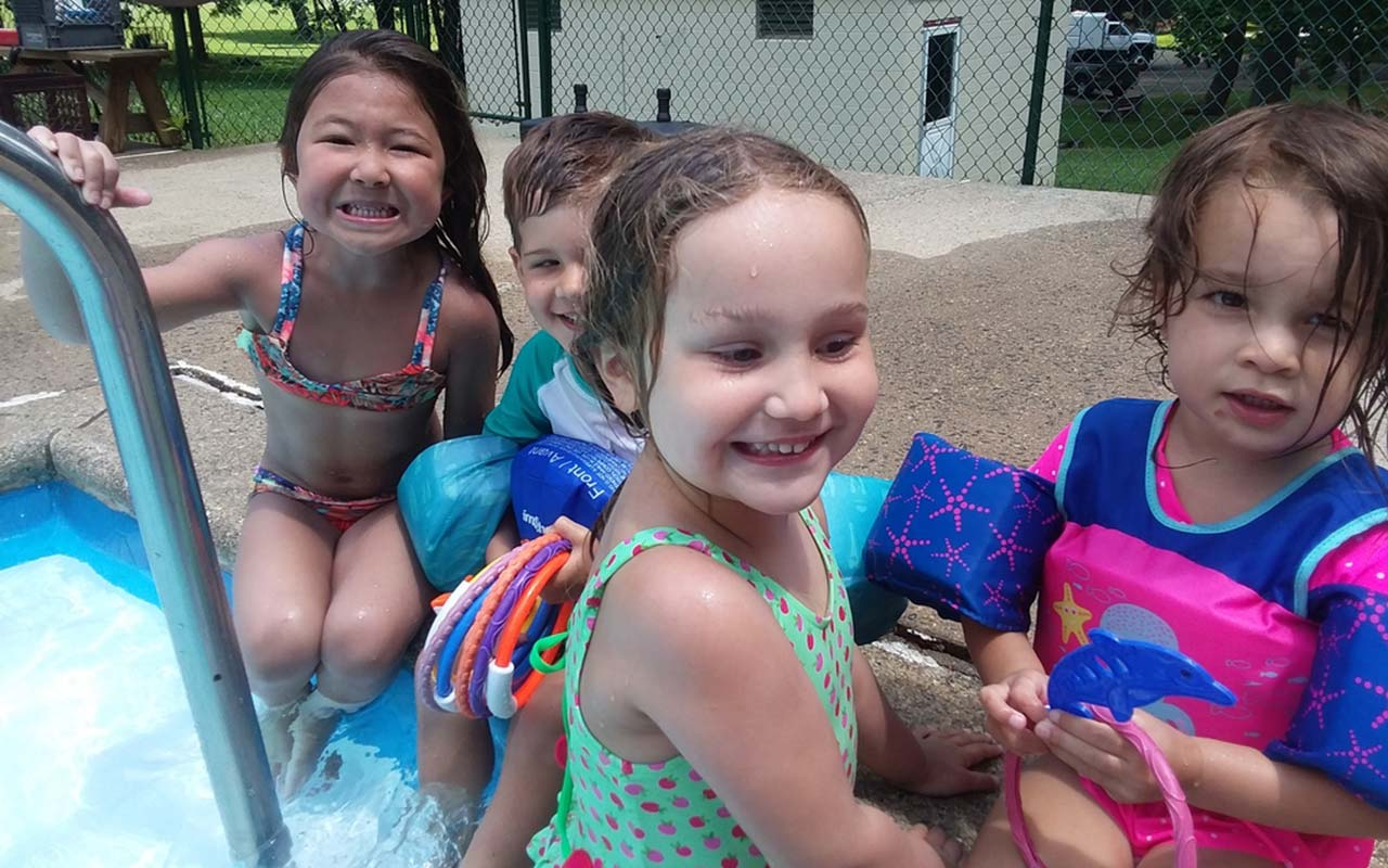 Young campers at poolside